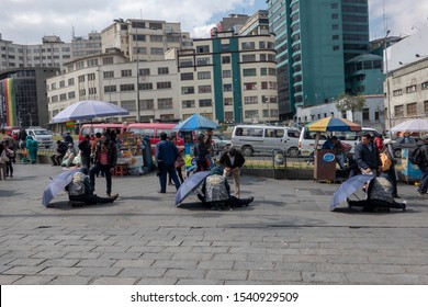 La Paz/Bolivia - 09.07.2019: Three shoeshiner