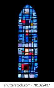 LA PERNELLE, FRANCE - JULY 1, 2011: Window of Sainte Patronille church in La Pernelle, France