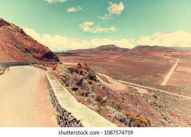 """la plaine des sables  : on the road leading to the""""piton de la fournaise"""" volcano on reunion island, indian ocean, old fashioned colors"""