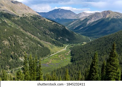 La Plata Peak - Summer view of Highway 82 winding in Lake Creek Valley at base of La Plata Peak (14,336 ft), part of Sawatch Range, seen from summit of Independence Pass (12,095 ft). Colorado, USA.