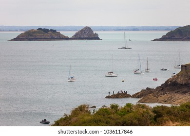 La Pointe du Grouin in Brittany, France. Sea landscape, with rocks, people and sailboats