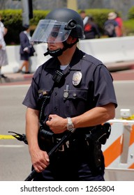 LA Police in riot gear watches over demonstrators at LA illegal emigrant rally. May 1st 2006