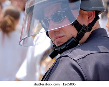 LA Police in riot gear watches over demonstrators at illegal emigrant rally. May 1st 2006