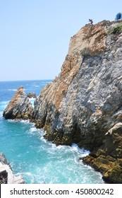 La Quebrada , famous dot of Acapulco in Mexico . Blue sea and magnificent landscape .