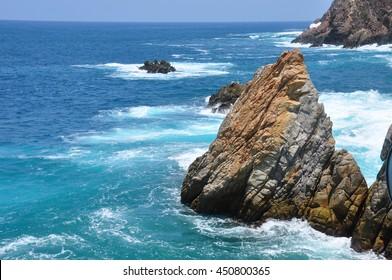 La Quebrada , famous dot of Acaulpco in Mexico . Blue sea and magnificent landscape .