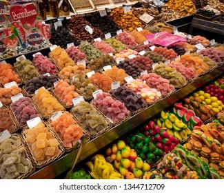La Rambla Markets, Barcelona, Spain: Stall selling lollies, sweets and snacks at the La Boqueria markets - a large public market in the Ciudad Vieja district of Barcelona, Catalonia, Spain.