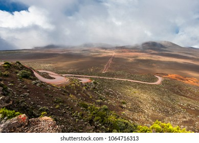 La Réunion or Reunion Island is a French department in the Indian Ocean. This picture shows the road onto the Plaine des Sables, which leads to the Piton de La Fournaise volcano.
