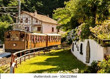 "LA RHUNE, FRANCE - JUNE 28, 2017: The small train of La Rhune - The ""Petit Train de La Rhune'' started running in 1924. It is useful to discover the breathtaking views at the summit of La Rhune."