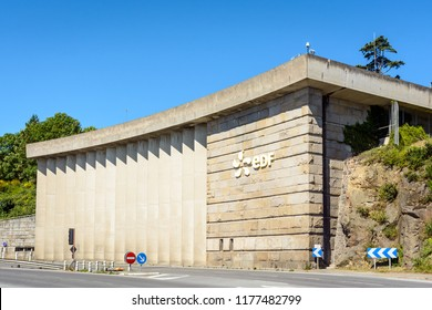 La Richardais, France - June 23, 2018: A building of the river Rance tidal power station run by french public electricity utility company EDF near Saint-Malo in Brittany.