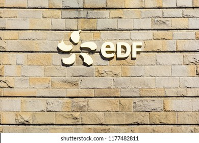 La Richardais, France - June 23, 2018: Logo of french public electricity utility company EDF on the stone wall of a building of the river Rance tidal power station near Saint-Malo in Brittany.