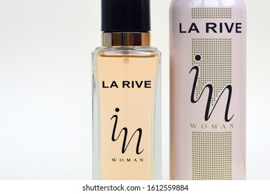 La rive IN woman deodorant and perfume bottles on beige background. LA RIVE S.A. is one of the leading producers of perfumes and perfumed waters in Europe