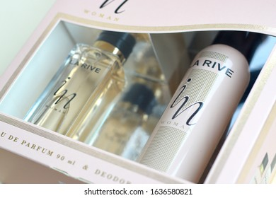 La rive IN woman deodorant and perfume bottles in brand box on beige background. LA RIVE S.A. is one of the leading producers of perfumes and perfumed waters in Europe