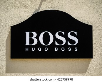 LA ROCA VILLAGE, BARCELONA, CATALONIA, SPAIN - MAY 2016 : silkscreen poster with the Hugo Boss logo, brand outside the official store