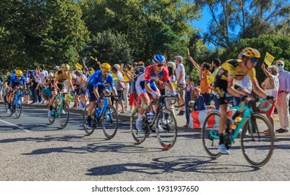 La Rochelle, France - September 08, 2020: Blurred image of the peloton riding fast in front of the spectators in La Rochelle during the stage 10 of Le Tour de France 2020.