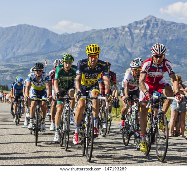 LA ROCHETTE, FRANCE- JUL 16: The peloton pedaling on a plain road after the ascension to Col de Manse in The Alps during the stage 16 of 100 edition of Le Tour de France on July 16 2013 in La Rochette