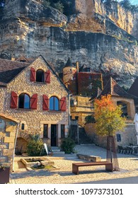 La Roque, Dordogne / France - September 24, 2017: Fall Colors Embellish a Medieval Home on the Dordogne River in Southern France