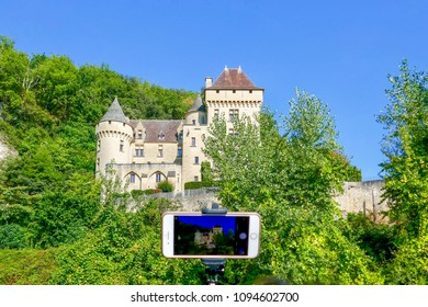 La Roque-Gageac, Dordogne / France - September 23, 2017: Camera shot of Selfie Taker on Dordogne Norbert River Cruise at La Roque-Gageac Castle