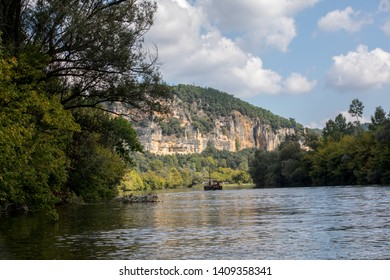 La Roque-Gageac, Dordogne, France - September 7, 2018: A tourist boat, in French called gabare, on the river Dordogne at La Roque-Gageac, Aquitaine, France