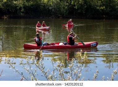 La Roque-Gageac, Dordogne, France - September 4, 2018: Canoeing on Dordogne river in La Roque-Gageac, Aquitaine, France