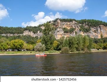 La Roque-Gageac, Dordogne, France - September 7, 2018: Canoeing on Dordogne river in La Roque-Gageac, Aquitaine, France
