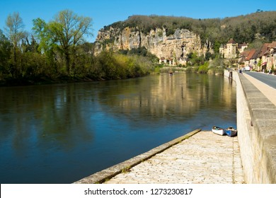 La Roque-Gageac, France -  3rd April 2017: The honeypot village of La Roque-Gageac is built under the cliffs beside the Dordogne River in Dordogne, Nouvelle Aquitaine, France.