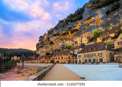 La Roque-Gageac, one of the most beautiful villages of France (Les Plus Beaux Villages), in dramatic sunset light. Roque Gageac is a popular tourist destination in Dordogne region.