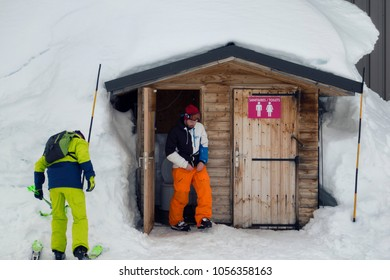 LA ROSIERE, FRANCE - MARCH 9, 2018: skier using toilet on the slope, the Italian and French alps are offering in 2018 superb skiing conditions for the winter season, with a lot of snow on the slopes.