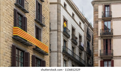 """La Senyera (""""flag"""" in Catalan) and mannequin on the balconies in Gothic Quarter of Barcelona. It is the official flag of Autonomous Community of Catalonia and symbol of pride for the Catalan people."""