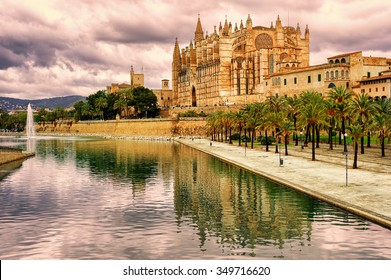 La Seu, the cathedral of Palma de Mallorca, reflecting in the water on sunset, Spain