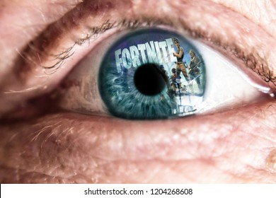 La Spezia, Italy - 10-16-2018: Fortnite game logo reflection on eye. Fortnite is one of the most popular battle royale games online. Game addiction.