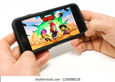 La Spezia - Italy - 12-12-2018: hands with Brawl Stars, a freemium multiplayer mobile arena fighter/party brawler video game developed and published by Supercell.