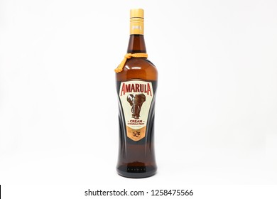 La spezia - Italy - 12/15/2018: bottle of Amarula cream liqueur isolated on white background. Amarula is a famous cream liqueur from South Africa and is made using the marula fruit