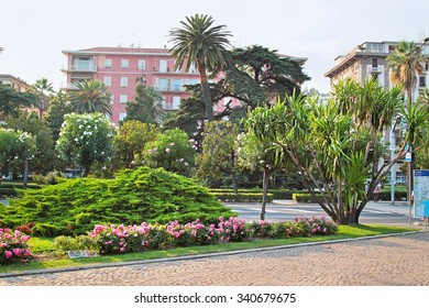LA SPEZIA, ITALY - AUGUST 08, 2015: Park with green plants and roses in La Spezia town in summer, Liguria, Italy.
