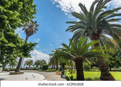 LA SPEZIA, ITALY - MAY, 2015: Wide-angle lens shot of promenade with palm trees