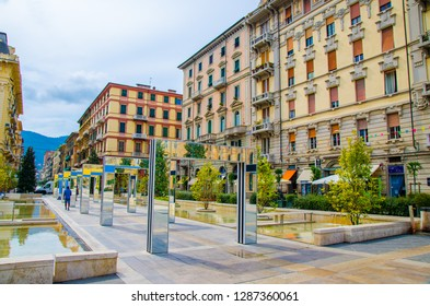La Spezia, Italy, September 13, 2018: alley with modern mirror arches with reflection by Daniel Buren on Piazza Giuseppe Verdi square among buildings in historical city centre, Liguria