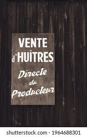 """La Teste de Buch, France - August 2019 : Sign indicating """"Oysters sales, directly from the oyster farmer"""" in French on the port of La Teste de Buch on the Arcachon bay"""
