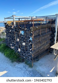 La Teste de Buch, France - August 2019 : Oyster collectors on disk, used for collecting oyster spat in oyster farming on the port of La Teste de Buch in France in the Arcachon bay