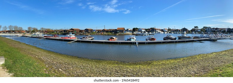 La Teste de Buch, France - August 2020 : Panoramic shot of the Port of La Teste de buch with pinasse boats moored to the pontoon