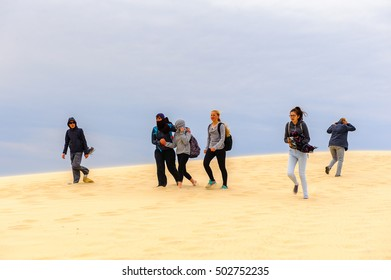 LA TESTE-DE-BUCH, FRANCE -OCT 12, 2016: Unidentified tourists on the top of the Dune of Pilat (Grande Dune du Pilat), the tallest sand dune in Europe.