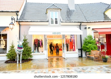 La vallee Village-Paris : December 7, 2018 : Environment high brand store at  Designer Outlet, La Valee Village shopping center in rainy day with people  finding and buy a christmas present for family