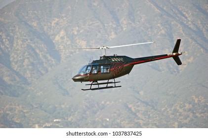 LA VERNE/CALIFORNIA - FEB. 11, 2018: Bell 206B helicopter performing maneuvers over Brackett Field Airport. La Verne, California USA