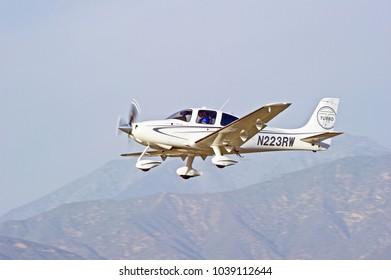 LA VERNE/CALIFORNIA - FEB. 11, 2018: Cirrus SR22-GS turbo aircraft approaching the runway to make a landing at Brackett Field Airport. La Verne, California USA