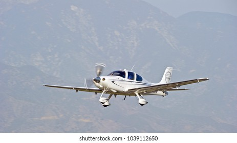LA VERNE/CALIFORNIA - FEB. 11, 2018: Cirrus SR22-GS turbo aircraft approaching the runway to make a landing at Brackett Field Airport. La Verne, California USA