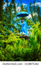 La Vierge Parasol - Famous statue of the Virgin Mary decorated with a parasol in the southeast of Reunion Island