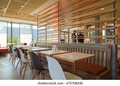 LA VILLE-AUX-DAMES, FRANCE - AUGUST 12, 2015: inside McDonald's restaurant. McDonald's is an American hamburger and fast food restaurant chain