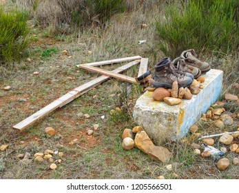 La Virgen del Camino, Castile and Leon, Spain - September 22, 2014: Camino markings: wooden arrow, pebbles and abandoned boots