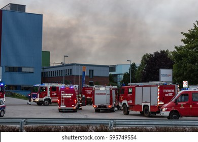 LAAKIRCHEN, AUSTRIA SEPTEMBER 24, 2015: Firefighters and fire truck with portable crane at fire in paper factory
