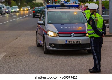 LAAKIRCHEN, AUSTRIA SEPTEMBER 24, 2015: Police stands guard at a roadblock, police car bloc after accident.