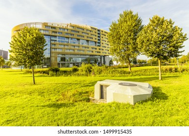 Laan der continenten, Alphen aan den Rijn, Zuid Holland, Netherlands, August 23, 2019: Living and working Building Da Vinci with German Tobruk bunker from WWII in the foreground
