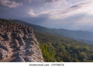 Laan Hin Pum Viewpoint and beam lighting on sky at Phu Hin Rong Kla National Park, Phitsanulok, Thailand.